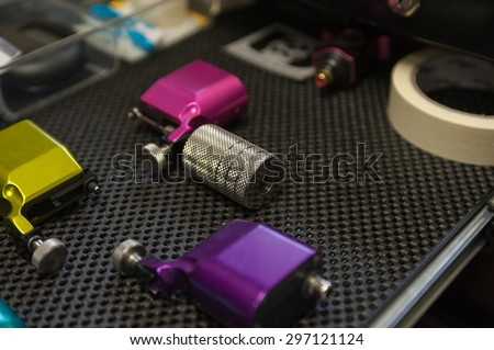Various electromagnetic tattoo guns for different jobs.