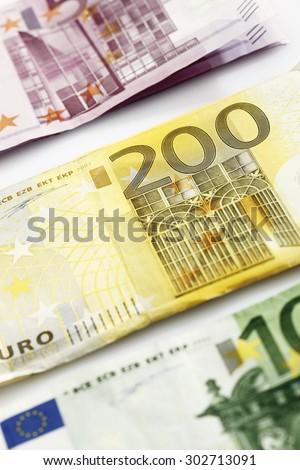 Various Euro bank notes in a row