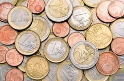 Various EURO coins for business, money, financial, cash, currency and economy concept. Pile of 1 Euro coin, 1 Cent coin, small, change of different european countries of the world for background.