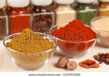 Various exotic spices in bowls. Selective focus on the curry powder.