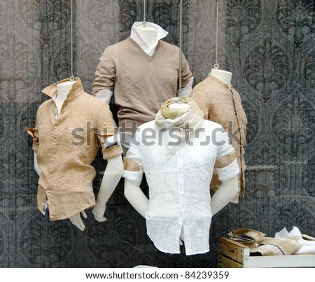 various fashionable men's shirt in shop window