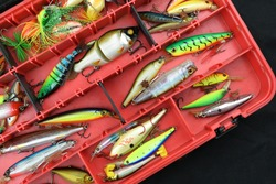Various fishing lures in the box.