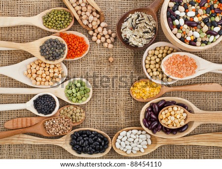 various food ingredients : beans, legumes, peas, lentils in wooden spoon on the sackcloth background #88454110