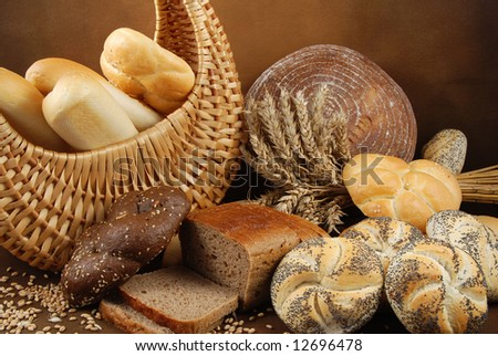 Various fresh baked goods with a basket, wheat grain and a cereal ears