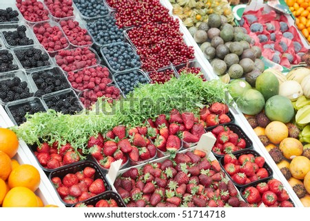 Various fresh berries on food market stall