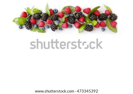 Various fresh summer berries. Ripe blueberries, raspberries and blackberries. Berries on white background. Top view #473345392