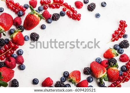Various fresh summer berries. Top view #609420521