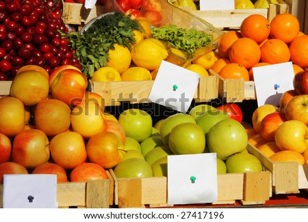 Various fresh vegetables and fruits at the market with price tag
