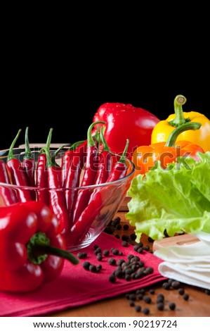 Various fresh vegetables on a kitchen table, over a dark background