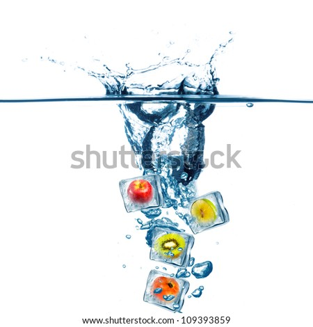 Various Fruit frozen in ice cube drop on water. Water splash