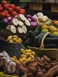 Various fruits and vegetables on display in typical indoor market Mercado 10 de Agosto in Cuenca Azuay Ecuador South America