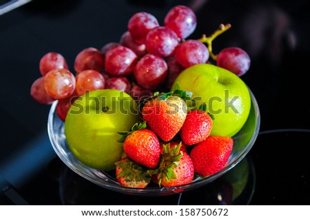 Various fruits - grapes, apple, strawberry