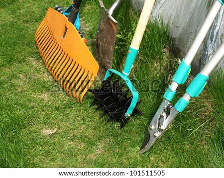 Various garden tools: shears, rake,aerator and spade