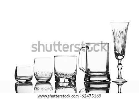 Various glass glasses on a white background with reflexion