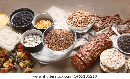 Various gluten free foods on wooden background.