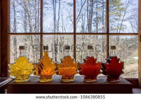 Various Grades Of Delicious Vermont Maple Syrup Lined Up On A Windowsill #1086380855
