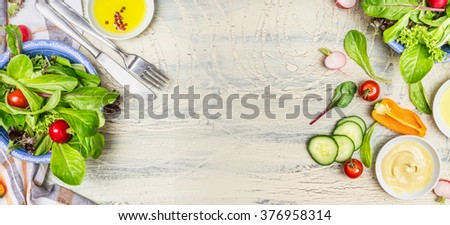 Various green organic salad ingredients on  light rustic background, top view, banner. Healthy  lifestyle or detox diet food  concept