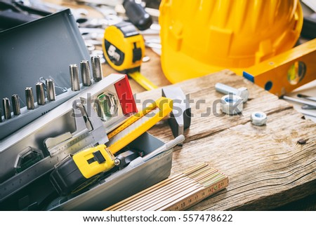 Various hand tools in a metal box #557478622
