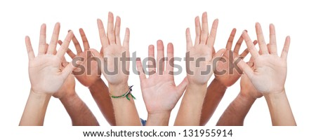 Various hands lifted up in the air. All on white background