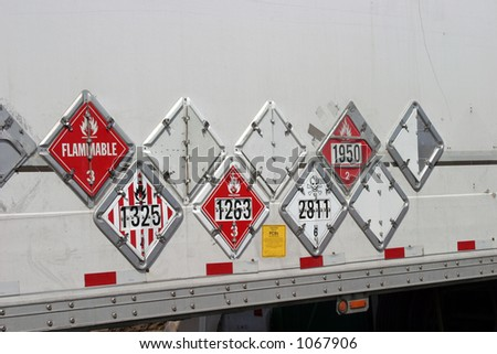 various hazard plackards on the side of a truck