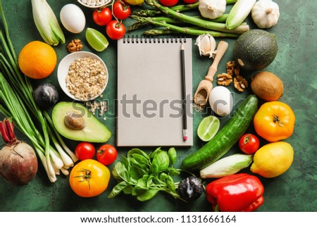 Various healthy products with notebook on color background #1131666164