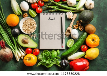 Various healthy products with notebook on color background. Diet concept #1193380228