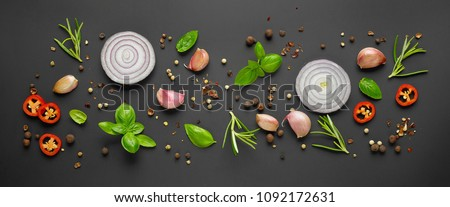 various herbs and spices on black background, top view #1092172631