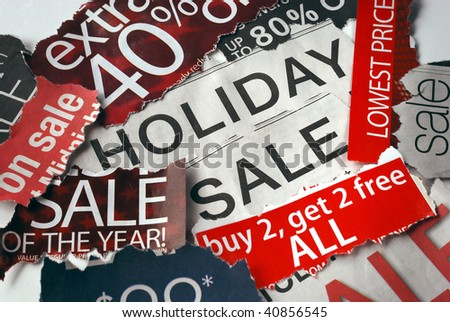 Various holiday on sale signs from the newspapers - stock photo
