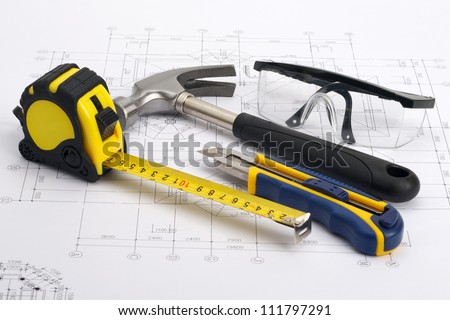 Various home tools on blueprint as home construction concept