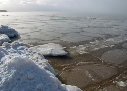 various ice formations in the sea, ice texture on the water surface, beautiful winter day by the sea, winter