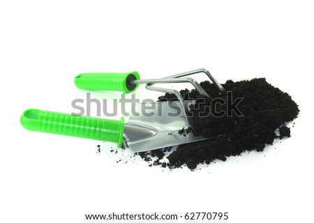 various implements for planting on a white background
