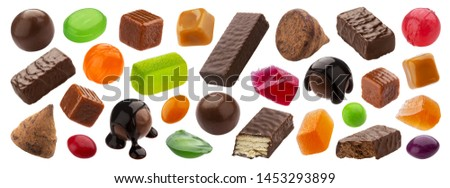 Various jelly candies, caramel, lollipops isolated on white background with clipping path. Different whole and broken dragee set, chocolate covered sweets, delicious confectionery collection