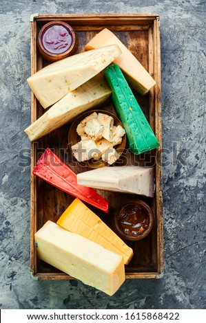Various kind of cheese served in wooden box