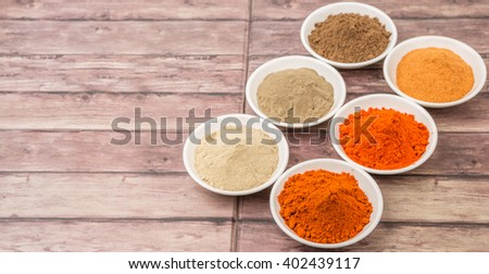 Various kind of hot and spicy chili powder in white bowl over background #402439117