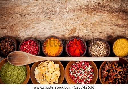 Various kind of spices in wooden bowls