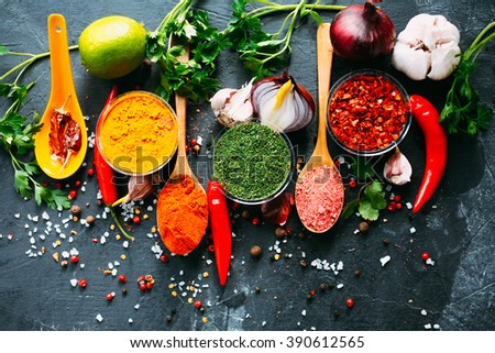 Various kind of spices on dark bacground - Shutterstock ID 390612565