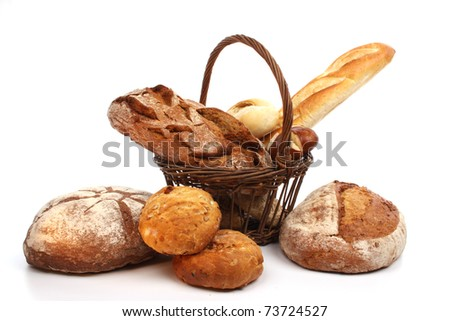 Various kinds of fresh baked  bread, breadrolls and buns - stock photo