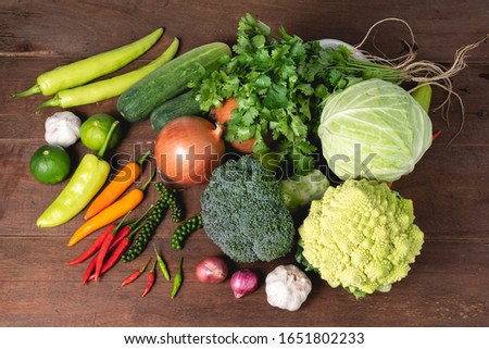 Various kinds of fresh vegetable on rustic wood background with copy space for text, garlic, cucumber, carrot, broccoli, cabbage, healthy organic veggie concept