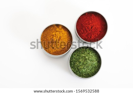 Various kinds of spices in cans