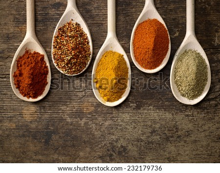 various kinds of spices in wooden spoons #232179736