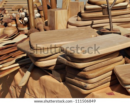 various kinds of wooden kitchen tools at the market