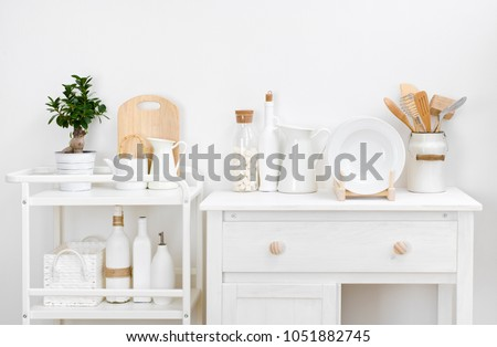 Various kitchen utensils and dishware with elegant vintage white furniture #1051882745