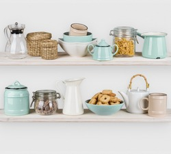 Various kitchen utensils and food ingredients isolated on wooden shelves
