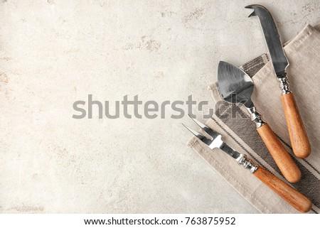 Various kitchen utensils on light textured background #763875952