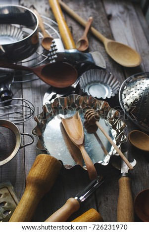 various kitchen utensils on rustic wooden table,  selective focus #726231970