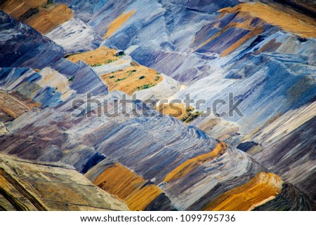 Various layers of earth in brown coal open pit. Cross Color.