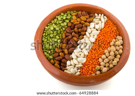 Various Legumes in earthenware brown crockery isolated iver white