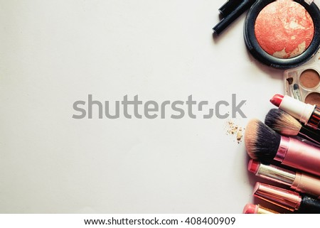 Various makeup products on white background with copy space.vintage tone