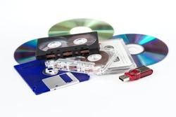 Various media - USB flash drive, CD-ROM, CD-cassette, floppy disks on a white background