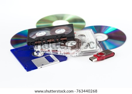 Various media - USB flash drive, CD-ROM, CD-cassette, floppy disks on a white background